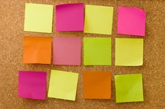 Colour notes on corkboard Stock Images