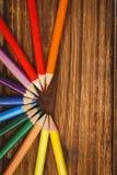 Colour ołówki na biurku w okręgu kształcie Fotografia Royalty Free