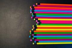 Colour ołówki odizolowywający na czarnym tle obraz royalty free