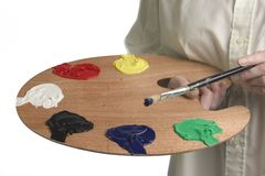 Colour Palette. Painter with palette in hand mixing oil paints Royalty Free Stock Photo