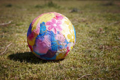 Paper ball on grass Royalty Free Stock Image