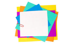 Colour paper with a paper clip. On white Royalty Free Stock Photos