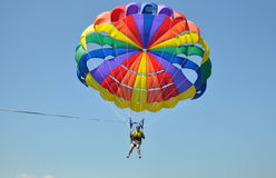 Colour parasail high up in the blue sky Royalty Free Stock Images