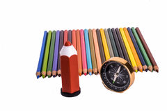 Colour pencil with compass, pen and a globe. Colour pencil with compass and  pen on white background Royalty Free Stock Image