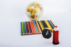 Colour pencil with compass, pen and a globe. On white background Stock Images