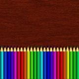 Colour pencil lying on wooden table Stock Images