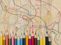 Colour pencils. On a wooden plank Stock Image