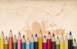 Colour pencils. On a dirty paper background Royalty Free Stock Photos