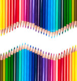 Colour Pencils. Two rows of colour drawing pencils, crayons Stock Image