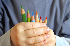 Colour pencils ahd children in hands Royalty Free Stock Photography