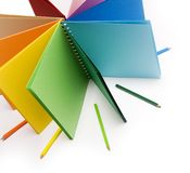 Colour Pencils And Colored Notebook Stock Photos