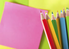 Colour Pencils And Postit For Reminder Note Stock Photography