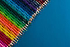 Colour pencils background. Colour pencils on blue background royalty free stock photos
