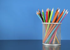 Colour pencils in the basket Royalty Free Stock Photos