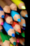 Colour pencils on black Royalty Free Stock Photos