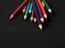Colour pencils  on black background close up Stock Image