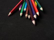 Colour pencils  on black background close up Stock Image