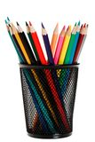 Colour pencils in black holder Stock Photo