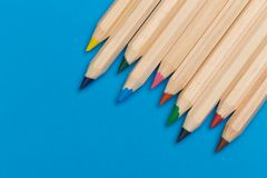 Colour pencils on blue background royalty free stock images