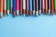 Colour pencils on blue background close up. back to school royalty free stock images