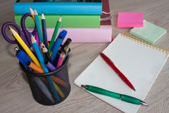 Colour pencils, calculator, notebook and office supplies, business accessories on table Stock Image