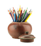 Colour pencils in clay jar Stock Photos