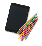 Colour pencils and computer tablet Royalty Free Stock Photography