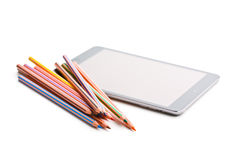 Colour pencils and computer tablet Stock Photos