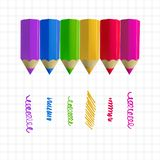 Colour pencils on copy-book paper Royalty Free Stock Photos