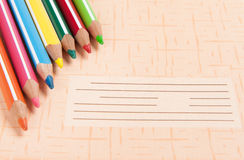 Colour pencils on copybook Royalty Free Stock Images