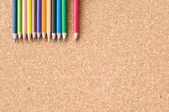 Colour pencils on cork board background. Close up royalty free stock images