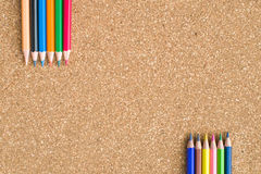 Colour pencils on cork board background. Close up royalty free stock photo