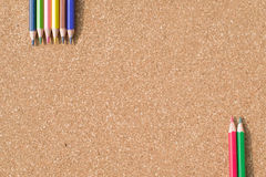 Colour pencils on cork board background. Close up royalty free stock photos