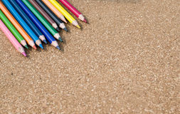 Colour pencils on cork board background. Close up stock photos
