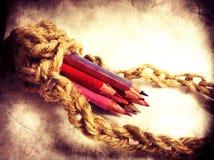 Colour pencils in crochet pencil holder Stock Image