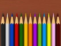 Colour pencils. 3d render of colour pencils over wooden table Stock Image