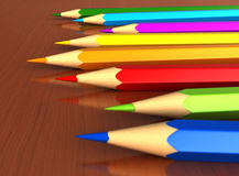 Colour pencils. 3d render of colour pencils over wooden table royalty free illustration
