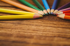 Colour pencils on desk in circle shape Royalty Free Stock Photo