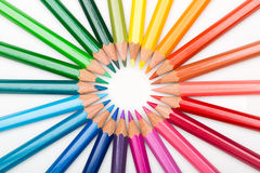 Colour pencils displayed in circle Royalty Free Stock Photos