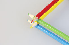 Colour pencils. Fold one-on-one crown. Royalty Free Stock Photos
