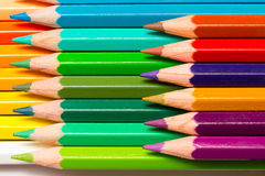 Colour Pencils. A group of colourful colour pencils lined up side by side and in layers Stock Photo