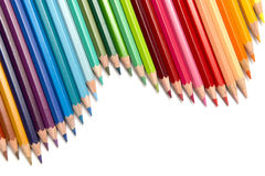 Colour Pencils. A group of colourful colour pencils lined up in a wave configuration Royalty Free Stock Images