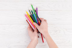 Colour Pencils in hands Royalty Free Stock Images