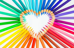 Colour pencils in heart sign Stock Photos