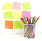 Colour Pencils In The Basket And Post It Royalty Free Stock Photos