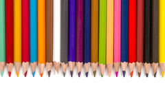 Colour pencils isolated on white background. A set of colored pencils disposed face down next to each other on a white background Stock Photography