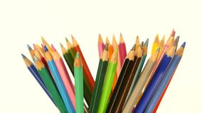 Colour pencils isolated on white, rotation stock video footage