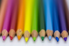 Colour Pencils layed out ona white backgrund stock image