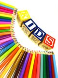Colour pencils  with learning blocks. Rainbow of colour pencils with learning blocks making a word kids Stock Photo