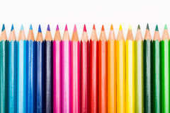 Colour pencils lined up in row Stock Images
